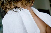 Close-up of a boy drying his face with a towel