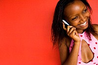 Close-up of a teenage girl talking on a mobile phone and smiling
