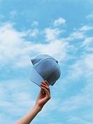 Hand holding cap