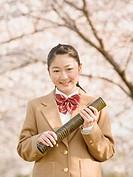 Teenagegirl graduate holding diploma