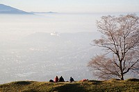 Three people sitting on mountain, Chiemgau Alps, Salzburg, Austria