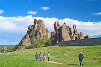 Tourists with castle on hill, Belogradchik Fortress, Belogradchik, Vidin, Romania