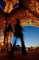 Silhouette of two people walking under tower, Eiffel Tower, Paris, France