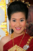 Young woman smiling in traditional clothing