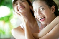 View of young women hugging (thumbnail)