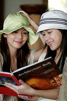 View of young women reading book