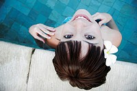 Portrait of a teenage girl standing in swimming pool (thumbnail)