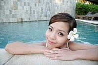 View of a teenage girl leaning by swimming pool