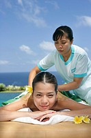View of a masseuse massaging a teenage girl