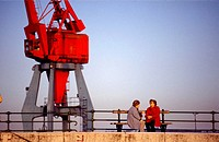 Women and crane at port of Santurtzi. Biscay, Euskadi, Spain