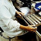 Mid section view of a man working in an electronic industry, Singapore