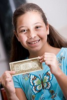 Portrait of a girl holding paper currency