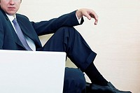 Businessman sitting in front of a laptop