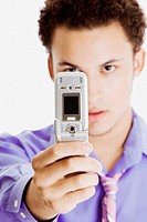 Close-up of a businessman taking a picture of himself