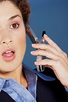 Close-up of a businesswoman talking on a mobile phone