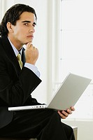 Side profile of a businessman with a laptop