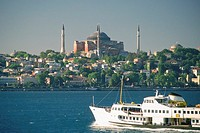 Ship in the sea with a museum in the background, Aya Sofya, Bosporus, Istanbul, Turkey