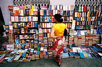 Rear view of a woman standing at bookstall, Yangon, Myanmar