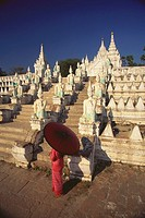 High angle view of a woman holding a parasol and standing in front of a pagoda, Mingun, Sagaing Divison, Myanmar