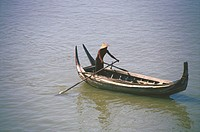 High angle view of a man rowing a rowboat in a river, Ayeyarwady River, Myanmar