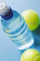 High angle view of a water bottle with two tennis balls