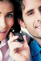 Portrait of a young couple using a mobile phone