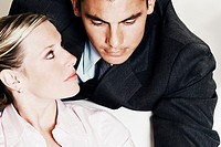Close-up of a businesswoman looking at a businessman