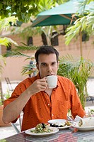 Portrait of a mid adult man drinking tea at a restaurant