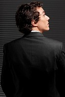 Rear view of a businessman looking up and thinking