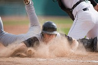 Baseball player sliding into home plate (thumbnail)