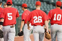Baseball players walking back to the dugout