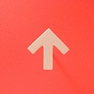 Directional arrow on orange background