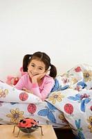 Girl 5-7 lying in bed