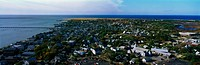 This is an aerial view of Cape Cod  We see the ocean on the left hand side and the new England town of Provincetown on the right