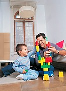 Father and Son Playing With Toy Blocks in Their Living Room