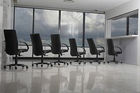 Queue of office chairs at reception desk