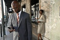 Young businessman holding mobile phone