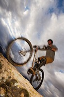 USA, Utah, mountain biker riding on slickrock