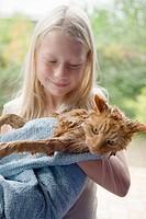 Girl with washed cat