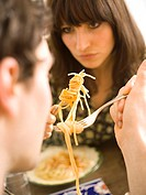 Couple eating spaghetti