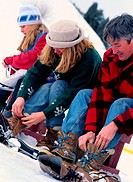 Family Putting on Ice Skates