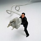 Businessman with Oversized Electrical Plug