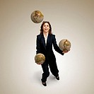 Businesswoman Juggling Globes