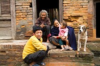 Nepal, Kathmandu, Bhaktapur, portrait of poor family outside their home