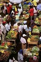 Caribbean, Grenada, Crowds of people in colorful fruit and vegetable market, View from above