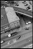 Aerial view of city street and elevated train tracks