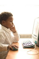Young boy working on computer