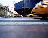 Low angle view of taxis driving through intersection
