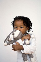 Portrait of young girl hugging stuffed animal