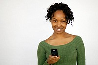 Off center portrait of young woman holding mobile phone